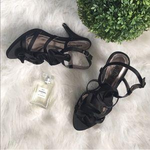 I listed Black Satin Rosette Heels Size 8.5 NIB